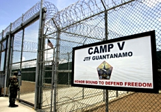Sign on the barbed wire fence surrounding the detention center at Guantanamo Bay.